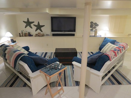 Harwich Cape Cod vacation rental - Lower level game room has comfy futons, video games, dart board.