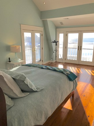 Harwich Cape Cod vacation rental - Master bedroom with decks and commanding water views.
