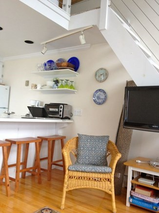Provincetown Cape Cod vacation rental - TV mounted on staircase. Cable TV, wifi, & dvr available in condo