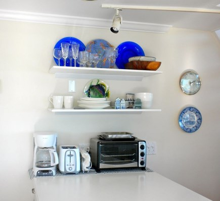 Provincetown Cape Cod vacation rental - Open shelving, unique serving pieces, bright blue accents