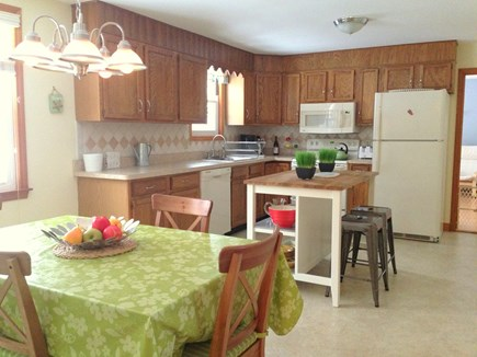 Falmouth Cape Cod vacation rental - Kitchen with extendable dining table, center island