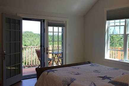 Truro Cape Cod vacation rental - Master bedroom looking out to the deck