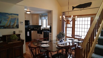 Hyannis Cape Cod vacation rental - Kitchen has microwave, dishwasher, stove, fridge with ice/water.