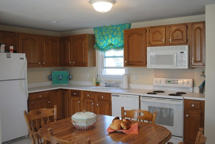 Falmouth, Maravista Cape Cod vacation rental - Eat-in kitchen adjacent to screened in porch.