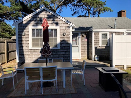 Dennis Port Cape Cod vacation rental - Outdoor shower and sitting area behind front home.