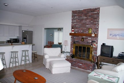 Eastham Cape Cod vacation rental - Living room with kitchen and dining area beyond