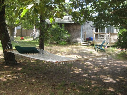 Eastham Cape Cod vacation rental - The view from the hammock to the house