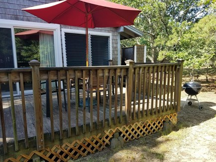 Eastham Cape Cod vacation rental - Side deck, grill and large outdoor shower off back of house