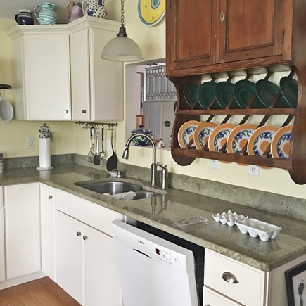 S Yarmouth Cape Cod vacation rental - Kitchen, with antiques and gas fireplace