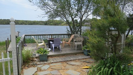 S Yarmouth Cape Cod vacation rental - Deck on fresh water pond with salt water coming in.
