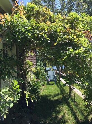 S Yarmouth Cape Cod vacation rental - Side garden leading to the back garden