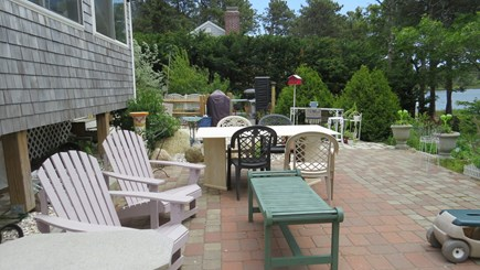S Yarmouth Cape Cod vacation rental - Belgium block patio with chairs and Italian marble dining table