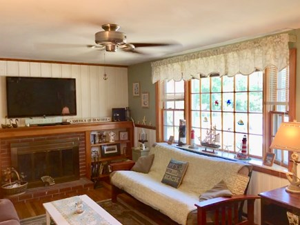 Dennisport Cape Cod vacation rental - Bright Living Room with 50 inch flat screen TV above fireplace
