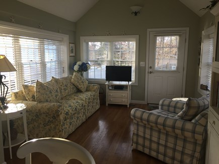 East Falmouth Cape Cod vacation rental - Sunroom off kitchen with access to back deck