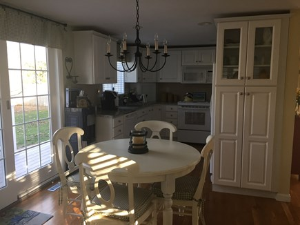 East Falmouth Cape Cod vacation rental - Eat in kitchen with French slider onto a spacious deck