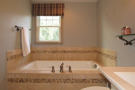 Chatham Cape Cod vacation rental - The bathrooms feature glass in showers and soaking tubs.