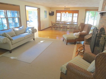 Harwich Cape Cod vacation rental - Living room flows into dining area and kitchen.