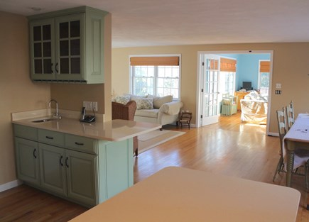 Harwich Cape Cod vacation rental - Social kitchen opens up to dining area and living room.