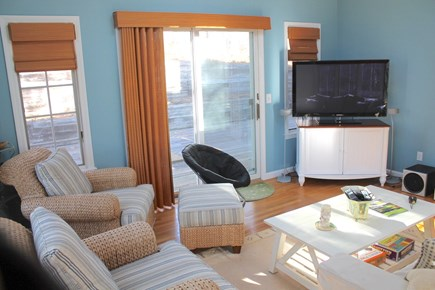 Harwich Cape Cod vacation rental - TV lounge walks out to private deck.