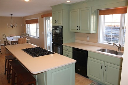 Harwich Cape Cod vacation rental - Open social kitchen with five burner range topin center island