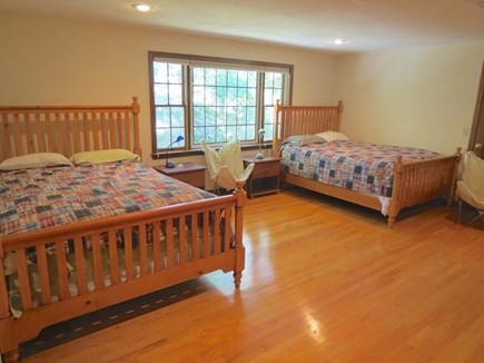 Harwich Cape Cod vacation rental - Upper level bedroom with a queen and two twins.