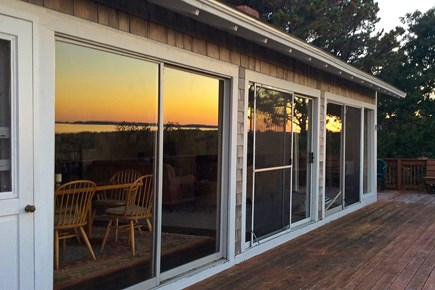 South Wellfleet Cape Cod vacation rental - Sunset reflected in deck sliders