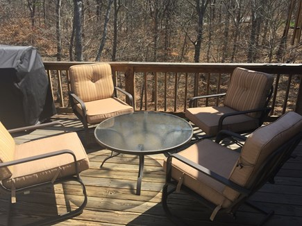 Brewster Cape Cod vacation rental - Deck.. dining table w umbrella + this conv set & Weber grille