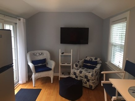 Brewster Cape Cod vacation rental - Family/TV area that steps onto blue-stone patio