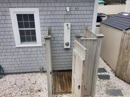 Dennisport Cape Cod vacation rental - Outdoor hot and cold shower. Shed for storage and beach gear.