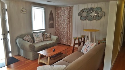 Dennisport Cape Cod vacation rental - Spacious living room with tucked away stackable washer and dryer.