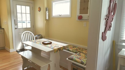 Dennisport Cape Cod vacation rental - Bench seating with underneath storage and wine fridge. 6+ seating