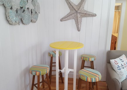 Dennisport Cape Cod vacation rental - Pub table and stools for additional eating space.