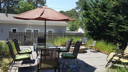 Dennisport Cape Cod vacation rental - Sun-filled upper deck. Dining for 6+. Loungers and Fire pit.