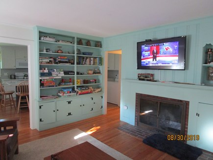 Falmouth Cape Cod vacation rental - Living room: cupboards with games/puzzles