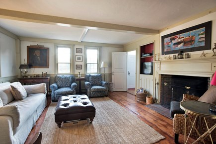 North Truro Cape Cod vacation rental - Spacious living room with original fireplace