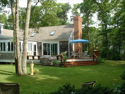 Barnstable Village Cape Cod vacation rental - Private backyard with deck, seating, grill and large lawn.