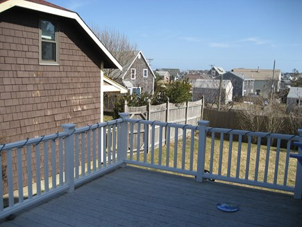 Bourne, Plymouth Cape Cod vacation rental - Deck and backyard. Deck has patio furniture and grill for summer.