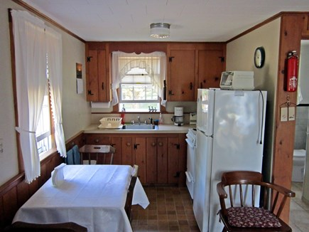West Chatham Cape Cod vacation rental - Kitchen has microwave oven, stove and fridge.