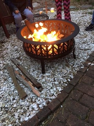 Harwich Cape Cod vacation rental - Patio with fire pit and gas grill