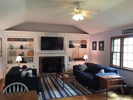 Harwich Cape Cod vacation rental - Great room with 2 sofas (one a queen sleeper), gas fireplace, TV