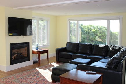 Truro Cape Cod vacation rental - Living room with gas fireplace, TV and comfortable furniture