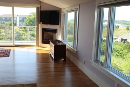 Truro Cape Cod vacation rental - Master Bedroom with gas fireplace, TV above, door to deck