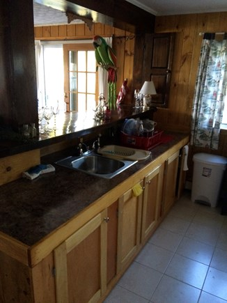 Bourne Cape Cod vacation rental - Airy kitchen w/stove (NO oven) looking on to the deck.