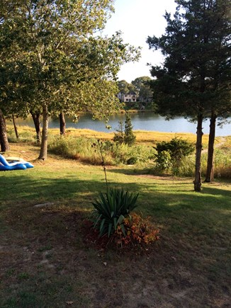 Bourne Cape Cod vacation rental - View of the backyard all the way to the Cove