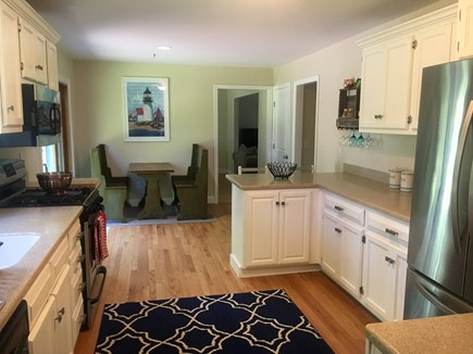 Eastham Cape Cod vacation rental - Spacious kitchen with sliders to the deck and back yard