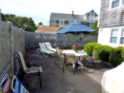South Yarmouth Cape Cod vacation rental - Private Back yard with table, chairs, lounge chairs and gas grill