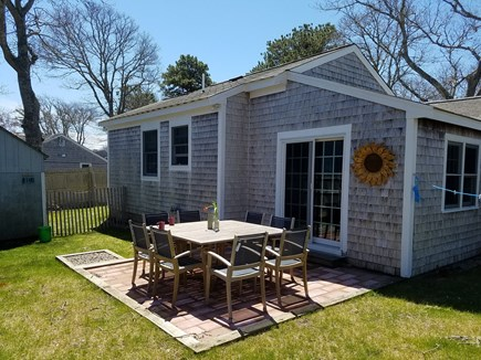 South Yarmouth Cape Cod vacation rental - Large Private fenced-in yard with teak patio table that sits 8!