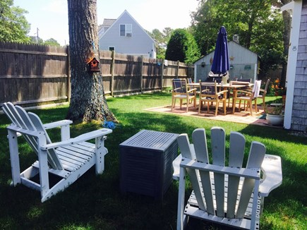 South Yarmouth Cape Cod vacation rental - Large private fenced- in backyard with patio, grill & teak table