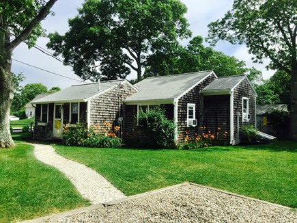South Yarmouth Cape Cod vacation rental - Large corner lot, crushed seashell walkway up to the front door.