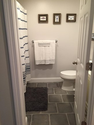 South Chatham Cape Cod vacation rental - Full guest bath with laundry & closet across on the other side.